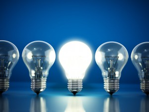 One lit bulb among unlit ones.